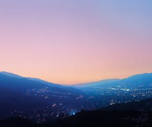 sky, city, and landscape image