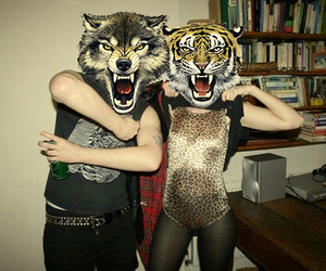 tiger, wolf, and boy image