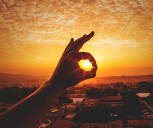 city, sunset, and hand image