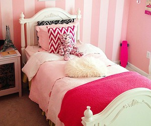 pink blanket, eiffel tower decor, and white bed frame image
