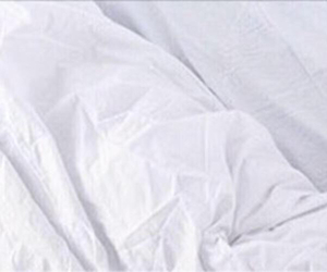 bed, white header, and bed sheets image