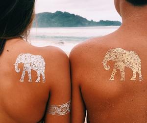 couple, elephants, and beach image