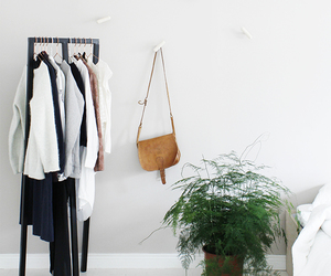 clothes rack, hay, and interior decor image