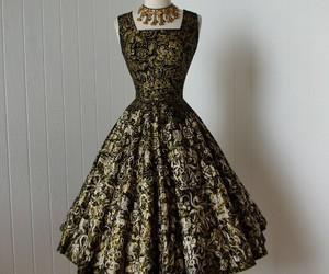 black, golden, and dress image
