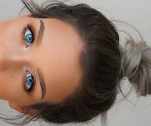 makeup, blue eyes, and bun image