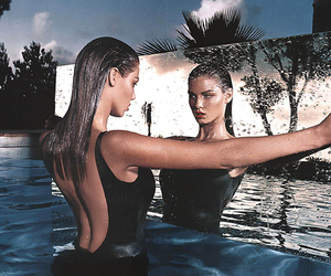 model, mirror, and water image