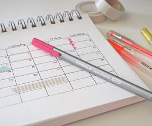 calendar, notebook, and pen image