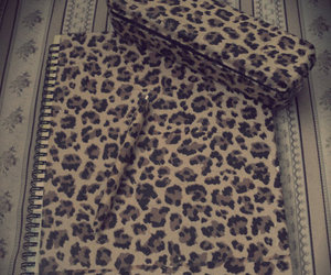leopard and notebook image