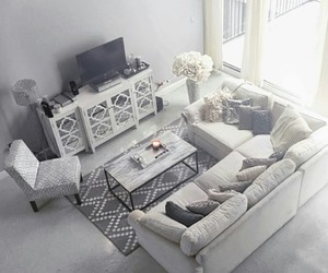 coffee table, pillows, and tv's image