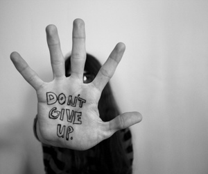 hand, black and white, and text image