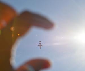 sky, plane, and sun image