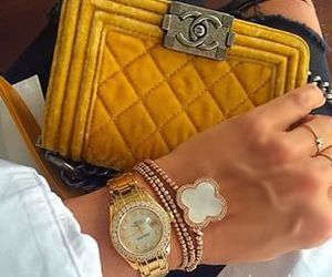 chanel, rolex, and hermeslouboutinlouis image