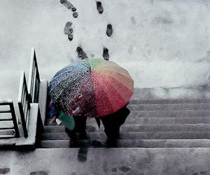 footprints, snow, and umbrella image