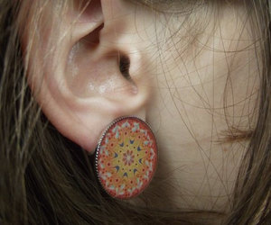 round earrings, clip on earrings, and yoga jewelry image
