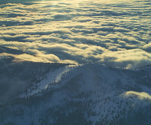 mountains, sun, and clouds image