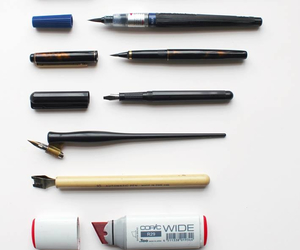Brushes, pen, and tool image