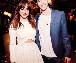 grant gustin, chloe bennet, and the flash image
