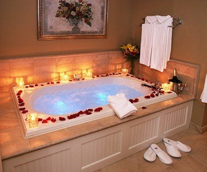 bath, rose petals, and water image