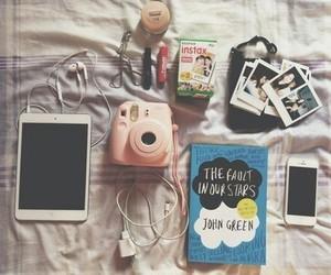 books, headphones, and iphone image
