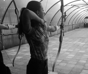 archery, arrow, and black and white image