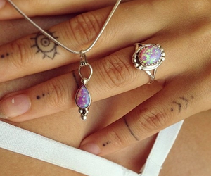 necklace, ring, and tattoo image