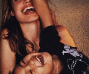 Angelina Jolie, laughing, and mom image