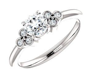 wedding ring, diamond engagement ring, and bridal set image