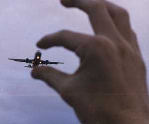 airplane, hand, and guy image