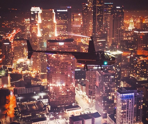 city, helicopter, and lights image