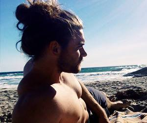 bun, sea, and long haired man image