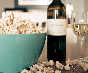 popcorn, wine, and food image