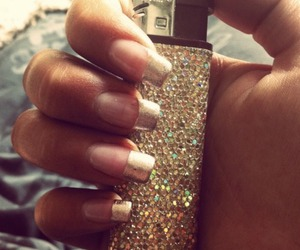 nails, lighter, and gold image
