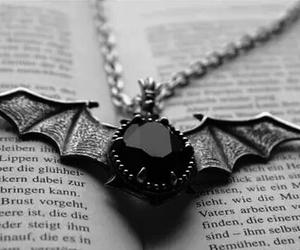 necklace, bat, and book image