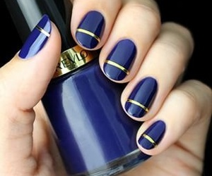 dark blue, gold, and nails image