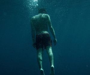 boy, water, and sea image