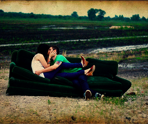 couple, kissing, and sofa image