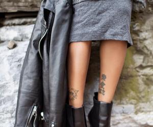 black woman, leather, and tatoo image