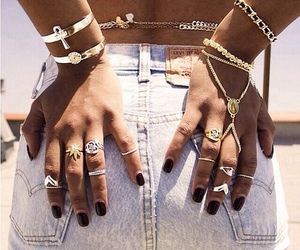 black and gold, rings, and white jeans image