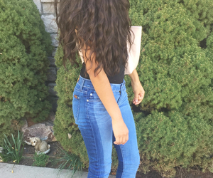 curly hair, heels, and jeans image