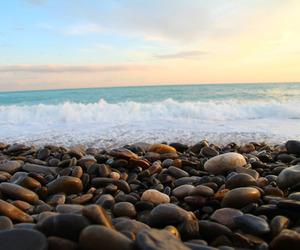 beach, rock, and ocean image
