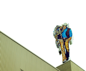 building and cowboy image