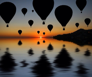 sunset, balloons, and sea image