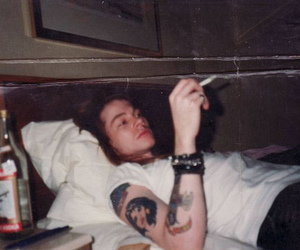 Guns N Roses, axl rose, and cigarette image