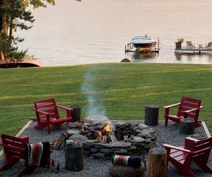 fire pit, lake, and picnic image
