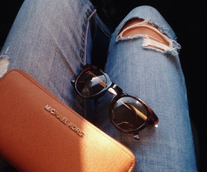 sunglasses and jeans image