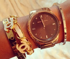 chanel, Michael Kors, and golden watch image