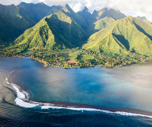 Island, mountains, and ocean image