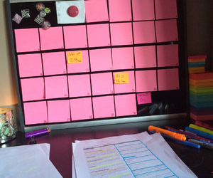 calendar, candle, and notes image