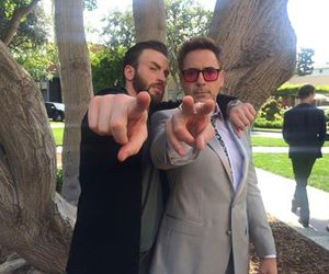 chris evans, robert downey jr, and Marvel image