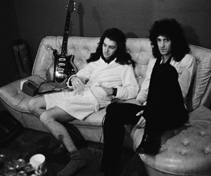 Queen, brian may, and john deacon image